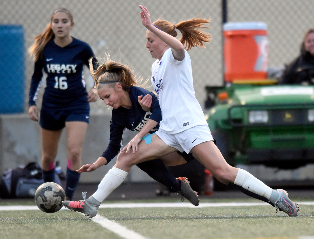 . Boulder High School\'s Alia Mentzell fights for the ball with Brooke Kercher-Pratt during a game against Legacy on Thursday at Recht Field in Boulder. More photo: BoCoPreps.com Jeremy Papasso/ Staff Photographer 04/12/2018