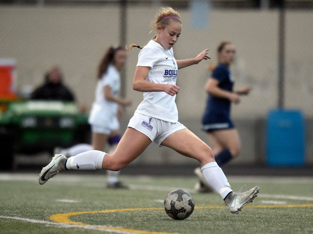. Boulder High School\'s Morgan Stone passes the ball upfield during a game against Legacy on Thursday at Recht Field in Boulder. More photo: BoCoPreps.com Jeremy Papasso/ Staff Photographer 04/12/2018