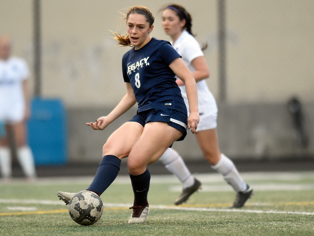 . Legacy High School\'s Analisa Carmosino passes the ball during a game against Boulder on Thursday at Recht Field in Boulder. More photo: BoCoPreps.com Jeremy Papasso/ Staff Photographer 04/12/2018