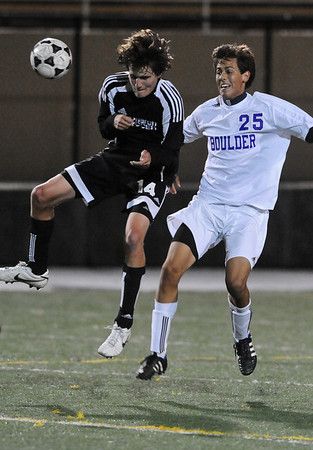 BVM<br /> Monarch's Makaley Hathaway heads the ball against Beau Salgado of Boulder. <br /> Photo by Marty Caivano/Camera/Oct. 12, 2010