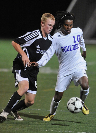 BVM<br /> Boulder's Brook Assefa fends off Jamie Falloon of Monarch.<br /> Photo by Marty Caivano/Camera/Oct. 12, 2010