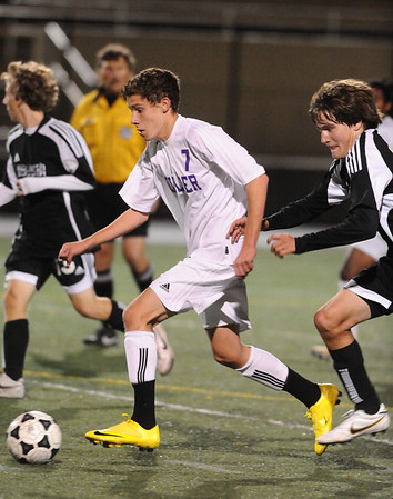 BVM<br /> Boulder's Will Maxwell moves the ball away from Makaley Hathaway of Monarch.<br /> Photo by Marty Caivano/Camera/Oct. 12, 2010