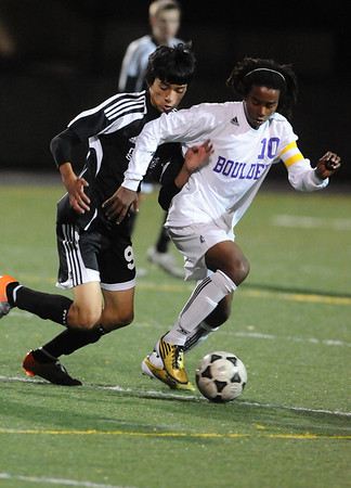 BVM<br /> Boulder's Brook Assefa fights off Clyde Glastetter of Monarch.<br /> Photo by Marty Caivano/Camera/Oct. 12, 2010