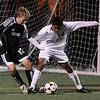 BVM<br /> Boulder's Enrique Womack keeps the ball away from Richard Moack of Monarch before scoring the second goal of the game.<br /> Photo by Marty Caivano/Camera/Oct. 12, 2010