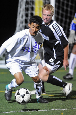 BVM<br /> Boulder's Rojesh Shrestha gets control of the ball ahead of Jamie Falloon of Monarch.<br /> Photo by Marty Caivano/Camera/Oct. 12, 2010