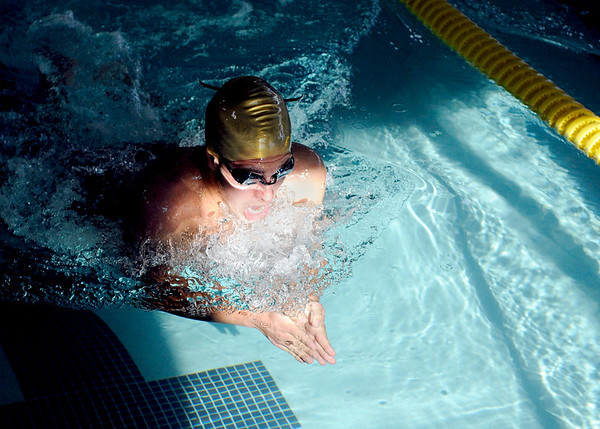 """Boulder High School's Jesse Gershman glides through the water during the 100-meter breastroke during a swim meet against Monarch High School on Friday, April 8, at the Louisville Recreation & Senior Center in Louisville. For more photos of the swim meet go to  <a href=""""http://www.dailycamera.com"""">http://www.dailycamera.com</a><br />  Jeremy Papasso/ Camera"""
