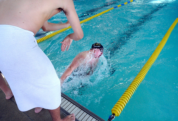 """Monarch High School swimmer Ryan Talley is cheered on by Monarch junior Austin Paswaters in the 100-meter breaststroke during a swim meet against Boulder High School on Friday, April 8, at the Louisville Recreation & Senior Center in Louisville. For more photos of the swim meet go to  <a href=""""http://www.dailycamera.com"""">http://www.dailycamera.com</a><br />  Jeremy Papasso/ Camera"""