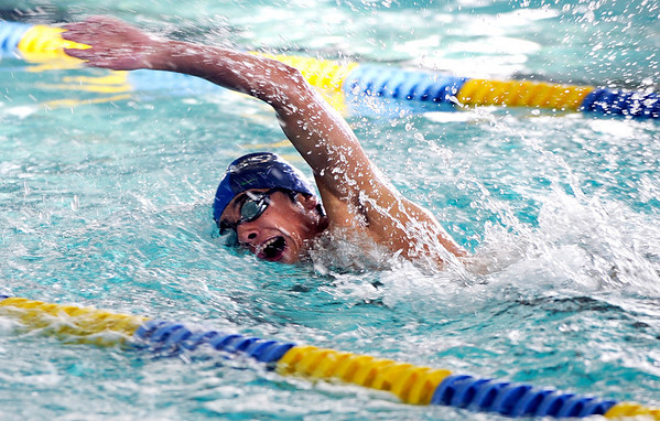 """Monarch High School's Alex Flores skims through the water in the 400-meter freestyle during a swim meet against Boulder High School on Friday, April 8, at the Louisville Recreation & Senior Center in Louisville. For more photos of the swim meet go to  <a href=""""http://www.dailycamera.com"""">http://www.dailycamera.com</a><br />  Jeremy Papasso/ Camera"""