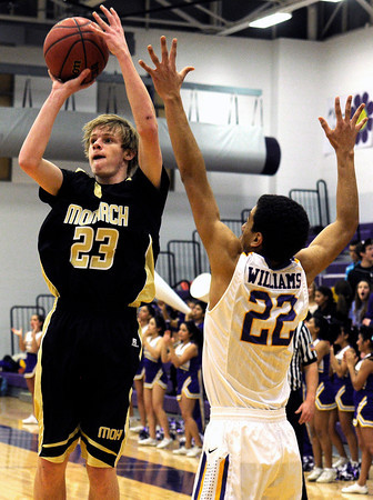 "Monarch High School's Kyle Billingsley takes a shot over Boulder's Austin Williams during a basketball game on Friday, Jan. 13, at Boulder High School. Monarch won the game 50-49. For more photos of the game go to  <a href=""http://www.dailycamera.com"">http://www.dailycamera.com</a><br /> Jeremy Papasso/ Camera"