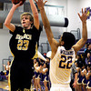 """Monarch High School's Kyle Billingsley takes a shot over Boulder's Austin Williams during a basketball game on Friday, Jan. 13, at Boulder High School. Monarch won the game 50-49. For more photos of the game go to  <a href=""""http://www.dailycamera.com"""">http://www.dailycamera.com</a><br /> Jeremy Papasso/ Camera"""