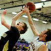 "Monarch High School's Kyle Billingsley, left, goes for a lay-up before getting fouled by Boulder High School's Marc Krimstock during a basketball game on Friday, Jan. 13, at Boulder High School. Monarch won the game 50-49. For more photos of the game go to  <a href=""http://www.dailycamera.com"">http://www.dailycamera.com</a><br /> Jeremy Papasso/ Camera"