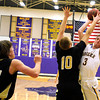 "Boulder High School's Marc Krimstock takes a shot over Monarch High School's Wes Moon, No. 10, during a basketball game on Friday, Jan. 13, at Boulder High School. Monarch won the game 50-49. For more photos of the game go to  <a href=""http://www.dailycamera.com"">http://www.dailycamera.com</a><br /> Jeremy Papasso/ Camera"