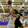 "Monarch High School's Wes Moon blocks the shot of Boulder High School's Austin Williams during a basketball game on Friday, Jan. 13, at Boulder High School. Monarch won the game 50-49. For more photos of the game go to  <a href=""http://www.dailycamera.com"">http://www.dailycamera.com</a><br /> Jeremy Papasso/ Camera"