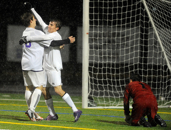 """Boulder High School's Matteo Wilczak, left, hugs Mason Douillard in front of goalkeeper Calet Serna after scoring a goal during a soccer game against Montbello on Wednesday, Oct. 24, at Recht Field in Boulder. For more photos of the game go to  <a href=""""http://www.dailycamera.com"""">http://www.dailycamera.com</a><br />  Jeremy Papasso/ Camera"""