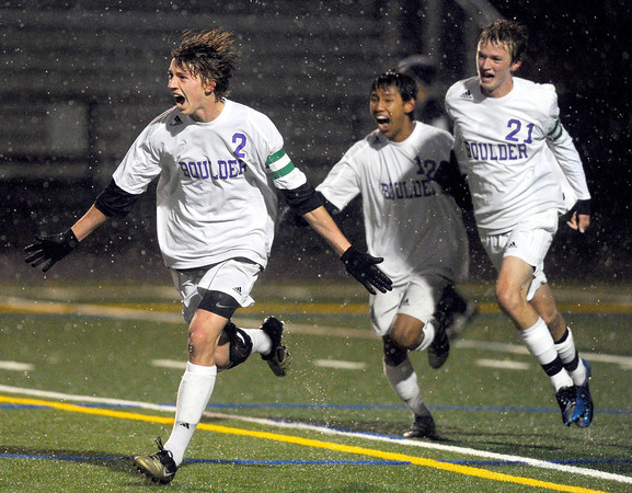 """Boulder High School's Kevin Van Lieshout, No. 2, celebrates after scoring a goal with Sushant Gurung, No. 12, and Lake Brant, No. 21, during a soccer game against Montbello on Wednesday, Oct. 24, at Recht Field in Boulder. For more photos of the game go to  <a href=""""http://www.dailycamera.com"""">http://www.dailycamera.com</a><br />  Jeremy Papasso/ Camera"""