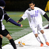 "Boulder High School's Rojan Shrestha tries to move the ball past a Montbello defender, not listed on roster, during a soccer game against Montbello on Wednesday, Oct. 24, at Recht Field in Boulder. For more photos of the game go to  <a href=""http://www.dailycamera.com"">http://www.dailycamera.com</a><br />  Jeremy Papasso/ Camera"
