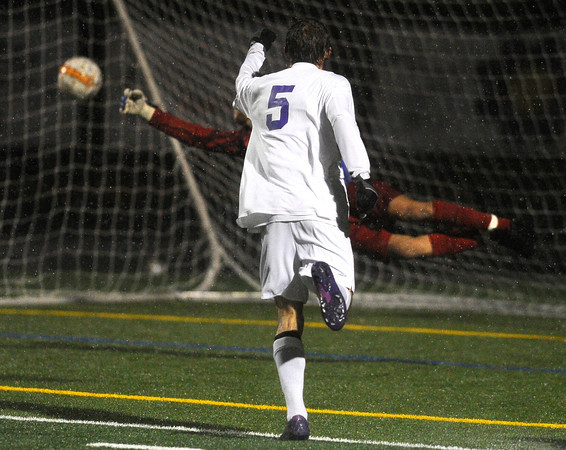 "Boulder High School's Mason Douillard raises his hand in celebration as the ball flies past goalkeeper Calet Serna during a soccer game against Montbello on Wednesday, Oct. 24, at Recht Field in Boulder. For more photos of the game go to  <a href=""http://www.dailycamera.com"">http://www.dailycamera.com</a><br />  Jeremy Papasso/ Camera"
