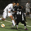 "Boulder High School's Javier Castruita fights for the ball with Diego Serna, No. 20, and Jose Tafoya, No. 24, during a soccer game against Montbello on Wednesday, Oct. 24, at Recht Field in Boulder. For more photos of the game go to  <a href=""http://www.dailycamera.com"">http://www.dailycamera.com</a><br />  Jeremy Papasso/ Camera"