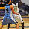 BHMTN01<br /> Boulder's Johnoy Albert looks to pass while being guarded by Nick Kuhl of Mountain Range.<br /> Photo by Marty Caivano/Camera/Jan. 26, 2010