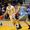 BHMTN06<br /> Boulder's Ethan Baker evades pressure from Derrick Valdez of Mountain Range.<br /> Photo by Marty Caivano/Camera/Jan. 26, 2010