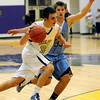 BHMTN04<br /> Boulder's Zach Wilson drives past Shawn Merritt of Mountain Range.<br /> Photo by Marty Caivano/Camera/Jan. 26, 2010