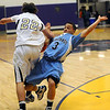 BHMTN03<br /> Boulder's Riley Grabau fouls Dacian Florez of Mountain Range.<br /> Photo by Marty Caivano/Camera/Jan. 26, 2010