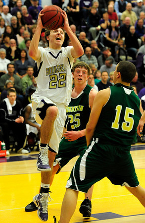 BHSMV<br /> Boulder's Riley Grabau shoots over Stephen Chipman, left, and Tony Kahn of Mountain Vista.<br /> <br /> Photo by Marty Caivano/March 2, 2011