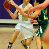 BHSMV<br /> Boulder's Ethan Baker looks to pass while being guarded by Jordan Anner of Mountain Vista.<br /> <br /> Photo by Marty Caivano/March 2, 2011