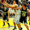 BHSMV<br /> Boulder's Loren ban fights for a rebound against Stephen Chipman of Mountain Vista.<br /> <br /> Photo by Marty Caivano/March 2, 2011