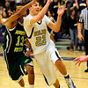 BHSMV<br /> Boulder's Riley Grabau passes while on the move and guarded by Cajetan Marez Tate of Mountain Vista.<br /> <br /> Photo by Marty Caivano/March 2, 2011