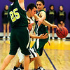 BHSMV<br /> Boulder's Andre Rieder struggles to keep control of the ball while under pressure from Stephen Chipman, left, and Jordan Anner of Mountain Vista.<br /> <br /> Photo by Marty Caivano/March 2, 2011
