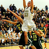 BHSMV<br /> Boulder's Andre Rieder snags a rebound past Mitch Carter of Mountain Vista.<br /> <br /> Photo by Marty Caivano/March 2, 2011