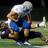 "Boulder High School's Tom Baugartner tackles Trend McFall during a game against Poudre High School on Friday, Sept. 14, at Boulder High School. For more photos of the game go to  <a href=""http://www.dailycamera.com"">http://www.dailycamera.com</a><br /> Jeremy Papasso/ Camera"