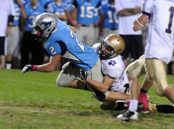 Boulder High School's Ian Metzger makes a tackle on Ralston Valley's Cory Witt on Friday, Sept. 30,during a football game against Ralston Valley at the North Area Athletic Complex. Boulder lost 48-0.<br /> Jeremy Papasso/ Camera
