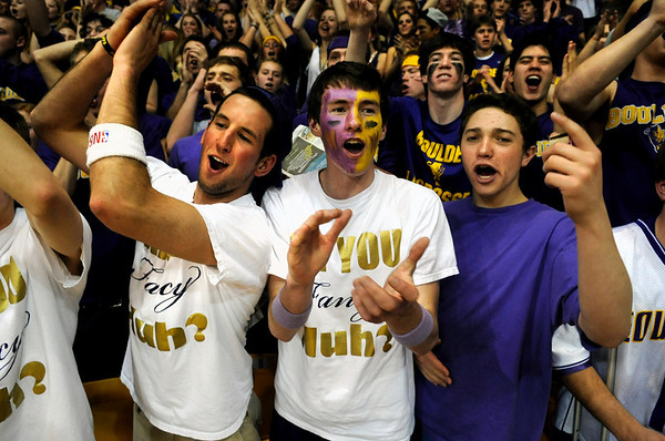 """Boulder High School senior Drew Noolas, left, senior Cole Carosella, and senior Jeremy Udis cheer for their team at the start of the Colorado State High School Athletic Association boys class 5A Championship game against Regis Jesuit High School at the Coors Events Center on the University of Colorado campus in Boulder. For more photos go to  <a href=""""http://www.dailycamera.com"""">http://www.dailycamera.com</a><br /> Jeremy Papasso/ Camera"""