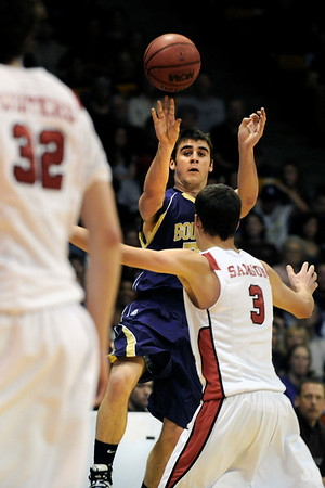 "Boulder High School senior Ethan Baker takes a shot over Regis's Tanner Samson during the Colorado State High School Athletic Association boys class 5A Championship game against Regis Jesuit High School at the Coors Events Center on the University of Colorado campus in Boulder. Boulder lost to Regis 59-63. For more photos go to  <a href=""http://www.dailycamera.com"">http://www.dailycamera.com</a><br /> Jeremy Papasso/ Camera"