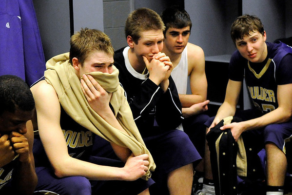 """Boulder High School senior Eric Rothweiller, center, and his fellow teammates mourn their loss in the locker room after losing to Regis during the Colorado State High School Athletic Association boys class 5A Championship game against Regis Jesuit High School at the Coors Events Center on the University of Colorado campus in Boulder. Boulder lost to Regis 59-63. For more photos go to  <a href=""""http://www.dailycamera.com"""">http://www.dailycamera.com</a><br /> Jeremy Papasso/ Camera"""
