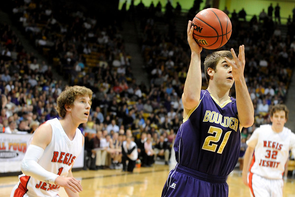 """Boulder High School senior Ethan Baker drives to the hoop during the Colorado State High School Athletic Association boys class 5A Championship game against Regis Jesuit High School at the Coors Events Center on the University of Colorado campus in Boulder. Boulder lost to Regis 59-63. For more photos go to  <a href=""""http://www.dailycamera.com"""">http://www.dailycamera.com</a><br /> Jeremy Papasso/ Camera"""