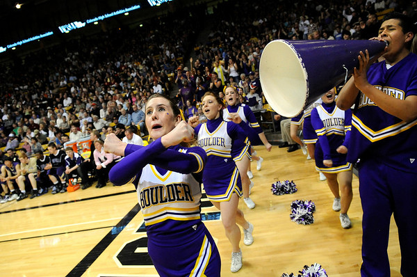 "Boulder High School cheerleaders Taylor Mangan, left, and Jose Alvarado, right, get the crowd going during the Colorado State High School Athletic Association boys class 5A Championship game against Regis Jesuit High School at the Coors Events Center on the University of Colorado campus in Boulder. Boulder lost to Regis 59-63. For more photos go to  <a href=""http://www.dailycamera.com"">http://www.dailycamera.com</a><br /> Jeremy Papasso/ Camera"
