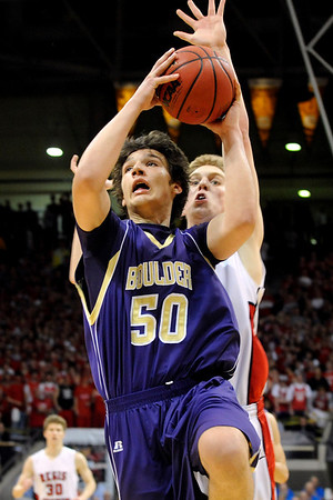"""Boulder High School junior Loren Ban drives to the hoop during the Colorado State High School Athletic Association boys class 5A Championship game against Regis Jesuit High School at the Coors Events Center on the University of Colorado campus in Boulder. Boulder lost to Regis 59-63. For more photos go to  <a href=""""http://www.dailycamera.com"""">http://www.dailycamera.com</a><br /> Jeremy Papasso/ Camera"""