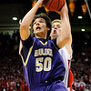 "Boulder High School junior Loren Ban drives to the hoop during the Colorado State High School Athletic Association boys class 5A Championship game against Regis Jesuit High School at the Coors Events Center on the University of Colorado campus in Boulder. Boulder lost to Regis 59-63. For more photos go to  <a href=""http://www.dailycamera.com"">http://www.dailycamera.com</a><br /> Jeremy Papasso/ Camera"