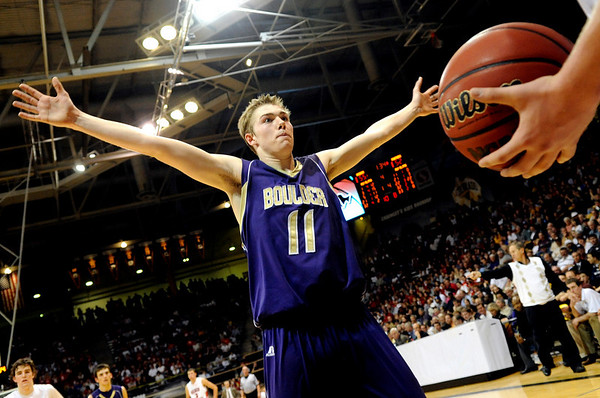 """Boulder High School senior Eric Rothweiller tries to block an inbound pass from a Regis player during the Colorado State High School Athletic Association boys class 5A Championship game against Regis Jesuit High School at the Coors Events Center on the University of Colorado campus in Boulder. Boulder lost to Regis 59-63. For more photos go to  <a href=""""http://www.dailycamera.com"""">http://www.dailycamera.com</a><br /> Jeremy Papasso/ Camera"""