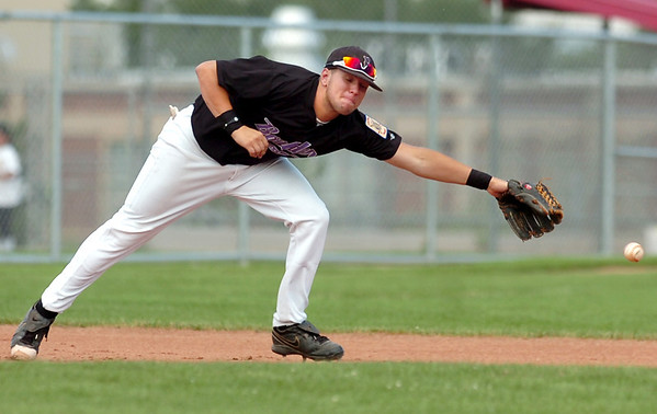 "Boulder's Danny Graves misses a ground ball on Friday, July 29, during a game against the Rocky Mountain Hit Club at Fairview High School in Boulder. Boulder defeated Rocky Mountain 8-6. For more photos go to  <a href=""http://www.dailycamera.com"">http://www.dailycamera.com</a><br /> Jeremy Papasso/ Camera"