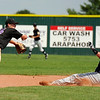 "Boulder's Colby Smith lunges for a wildly thrown ball as Rocky Mountain Hit Club's Danny Graves slides into second base safely on Friday, July 29, during a game at Fairview High School in Boulder. Boulder defeated Rocky Mountain 8-6. For more photos go to  <a href=""http://www.dailycamera.com"">http://www.dailycamera.com</a><br /> Jeremy Papasso/ Camera"