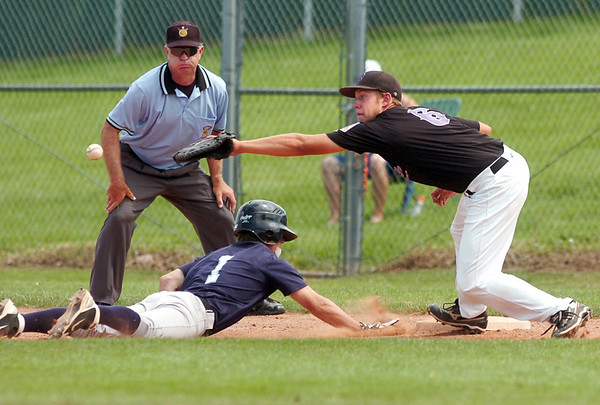 "Rocky Mountain Hit Club's Ryan Silva slides back to first base as Boulder's Ben Rice tries to recover a wildly thrown ball on Friday, July 29, during a baseball game at Fairview High School in Boulder. Boulder defeated Rocky Mountain 8-6. For more photos go to  <a href=""http://www.dailycamera.com"">http://www.dailycamera.com</a><br /> Jeremy Papasso/ Camera"
