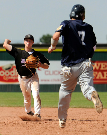 "Boulder's Stephen Galambos makes a double play as Fred Good runs towards second base on Friday, July 29, during a game against the Rocky Mountain Hit Club at Fairview High School in Boulder. Boulder defeated Rocky Mountain 8-6. For more photos go to  <a href=""http://www.dailycamera.com"">http://www.dailycamera.com</a><br /> Jeremy Papasso/ Camera"
