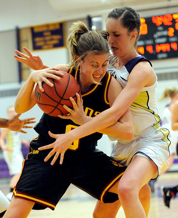 Boulder's Madilin Gates (right) pressures Rocky Mountain's Paige Applegate (left) during their basketball game at Boulder High School in Boulder, Colorado February 9, 2010.  CAMERA/Mark Leffingwell