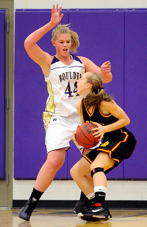 Boulder's Ande Lampert (left) blocks Rocky Mountain's Amber Winger (right) during their basketball game at Boulder High School in Boulder, Colorado February 9, 2010.  CAMERA/Mark Leffingwell