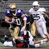 "Boulder High School's Abel Brown tries to break a tackle from defenders on Friday, Sept. 16, during a football game against Smoky Hill High School at Recht Field in Boulder. For more photos of the game go to  <a href=""http://www.dailycamera.com"">http://www.dailycamera.com</a><br /> Jeremy Papasso/ Camera"
