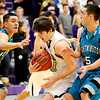 Boulder's Ethan Baker (middle) gets past Westminster's Greg Stephens (left) and Jardan Baker (right)  during their basketball game at Boulder High School in Boulder, Colorado February 23, 2010.  CAMERA/Mark Leffingwell
